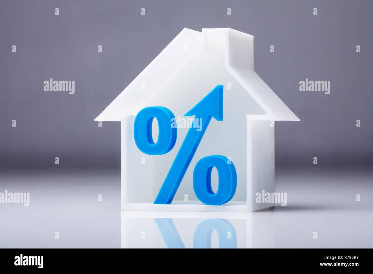 Percentage Symbol Inside House Model - Stock Image