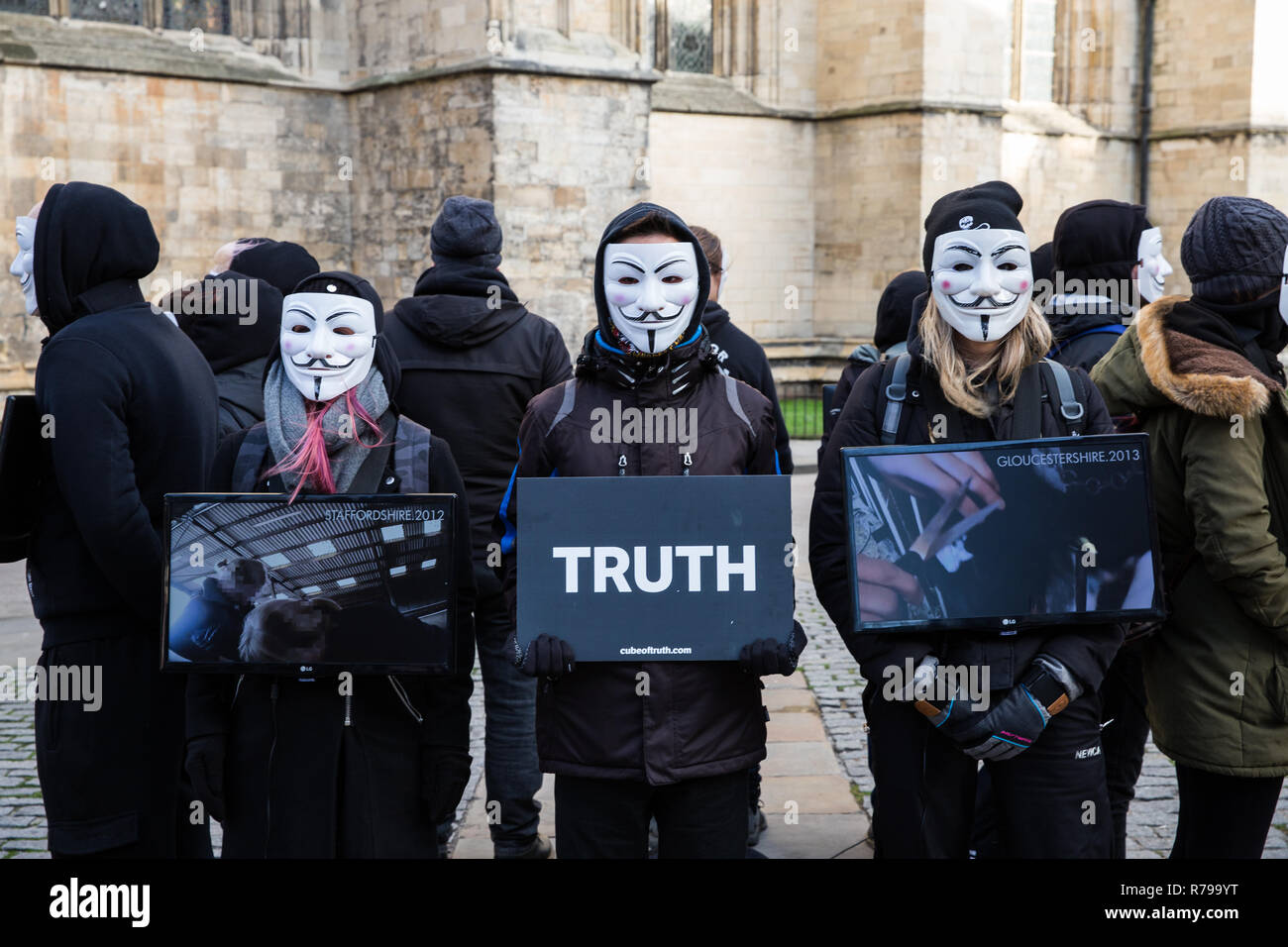 YORK, UK - DECEMBER 8, 2018.  Members of the Cube of Truth Vegan protest group in Guy Fawks masks and protesting about cruelty to animals. - Stock Image