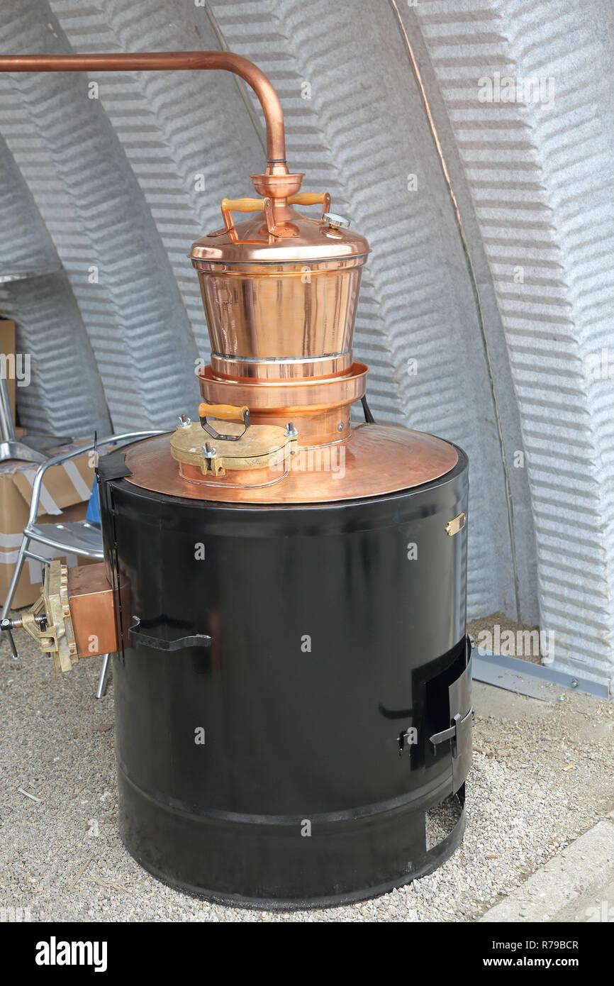 Copper Still Distiller - Stock Image