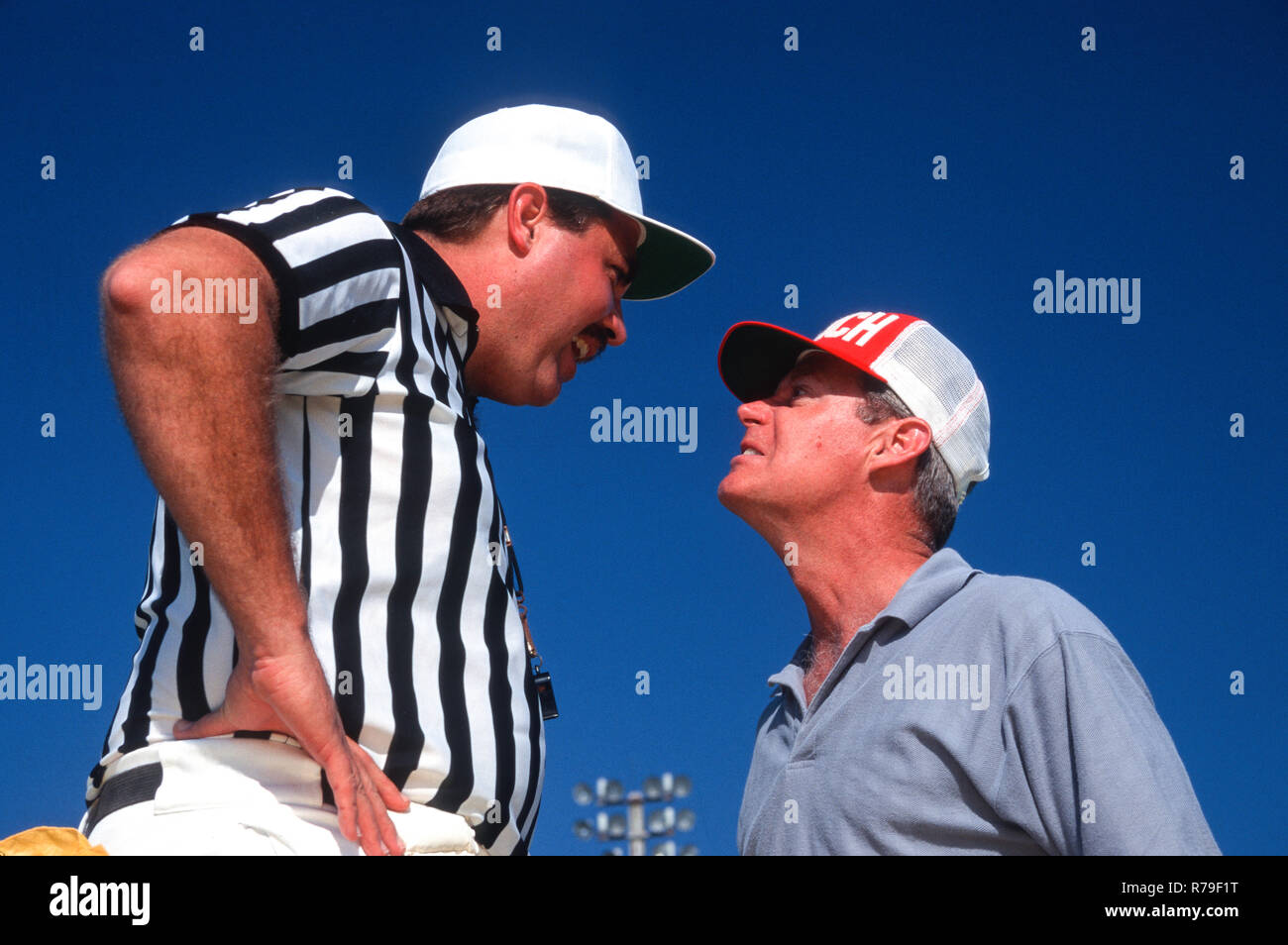 Coach argues with a referee at an American football game, USA - Stock Image