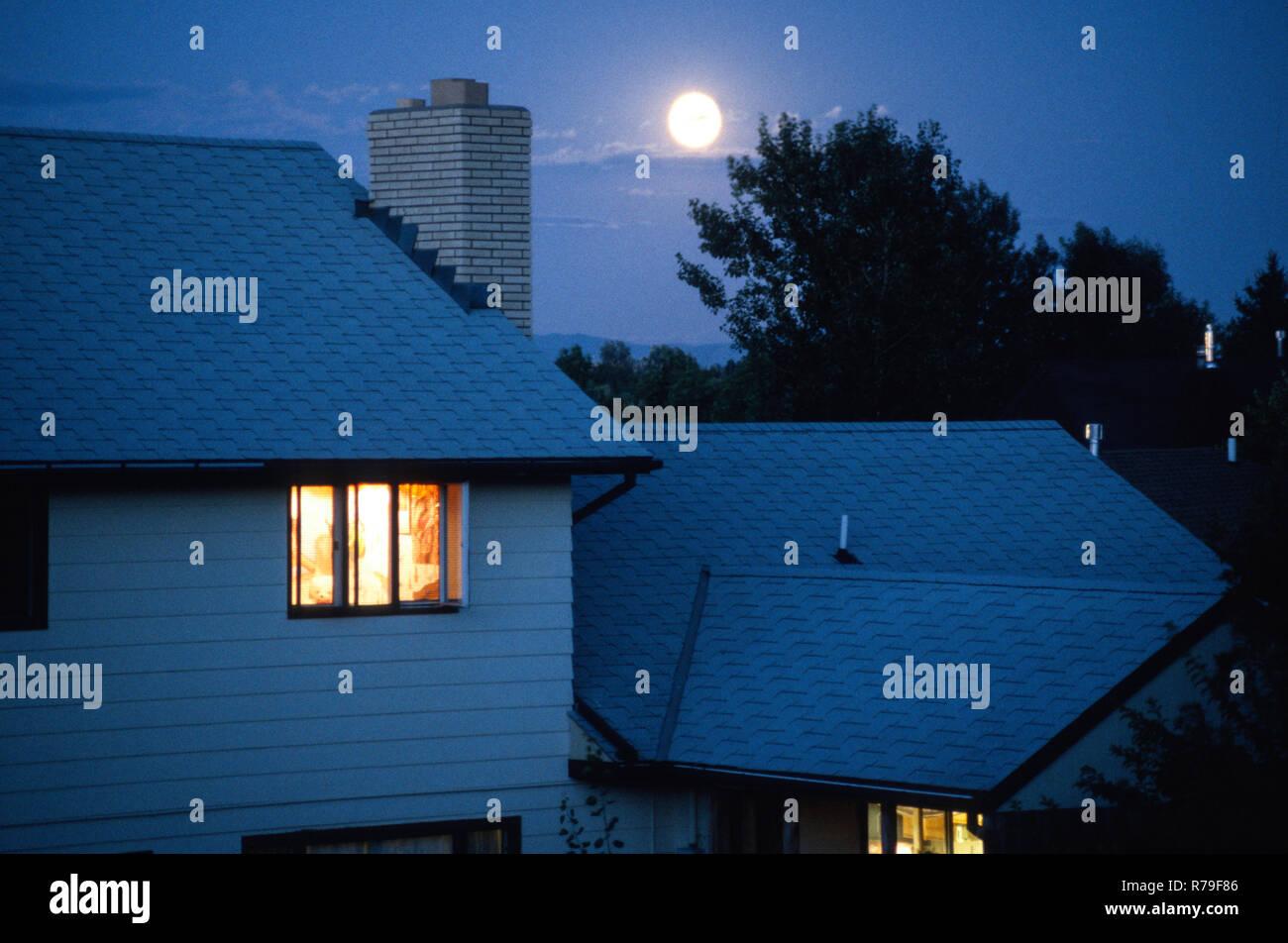 Moonrise over suburban neighborhood in Montana, USA - Stock Image