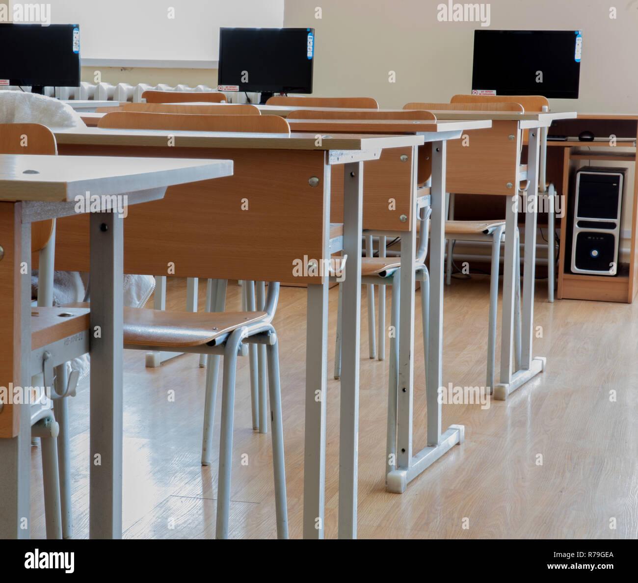 Elementary school classroom in Ukraine, school desks in the ...