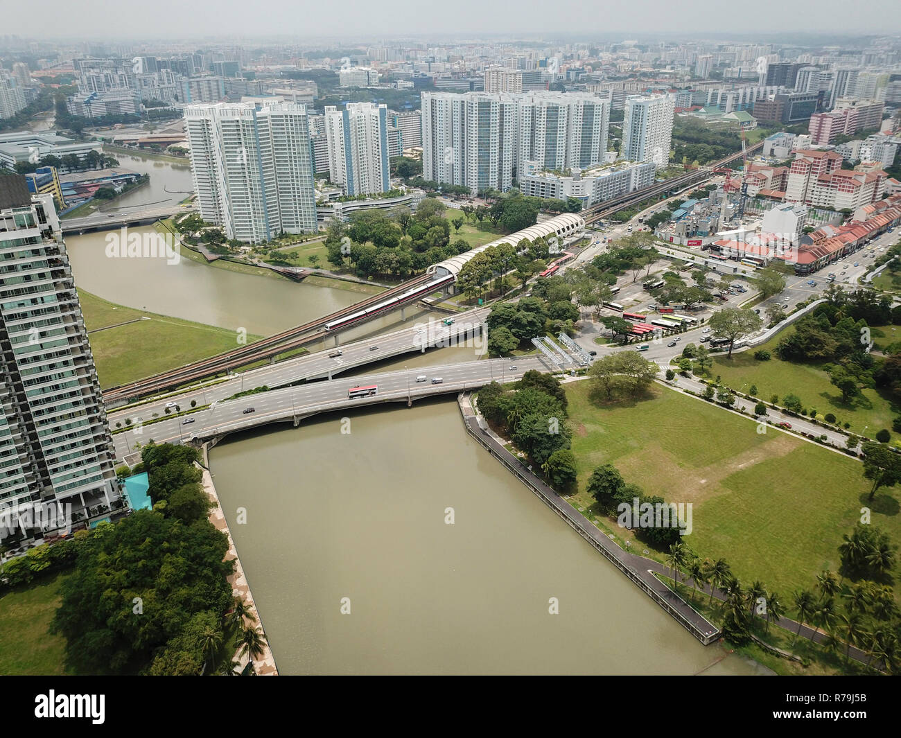 Drone aerial landscape of the Kallang River and surrounding buildings, captured at Kallang, Singapore.   Image captured on 2nd April 2018. Stock Photo