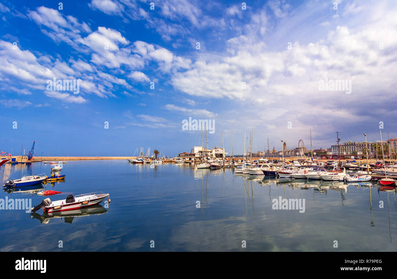 Bari, Italy, Puglia: Beautiful landscape with fishing boats, yaght and blue sea against the sky - Stock Image