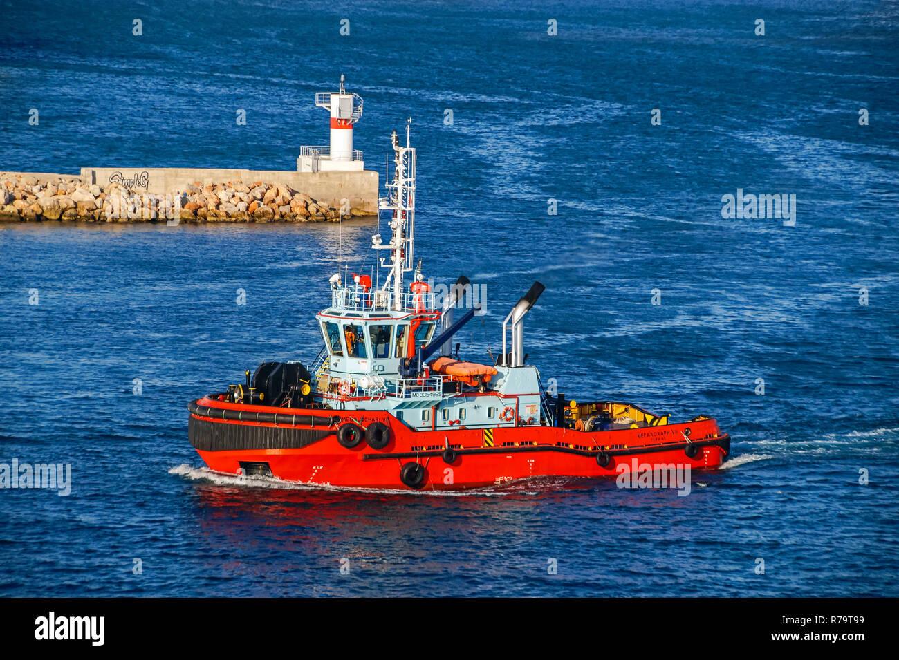 Tug boat megalochari VI at entrance to port of Piraeus