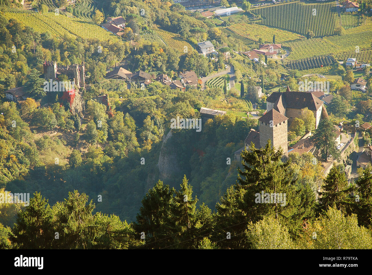 Aerial view of Tyrol Castle and Brunnenburg castle in Tirolo, South Tyrol, Italy. Tyrol Castle is home to the South Tyrolean Museum of Culture and Pro Stock Photo