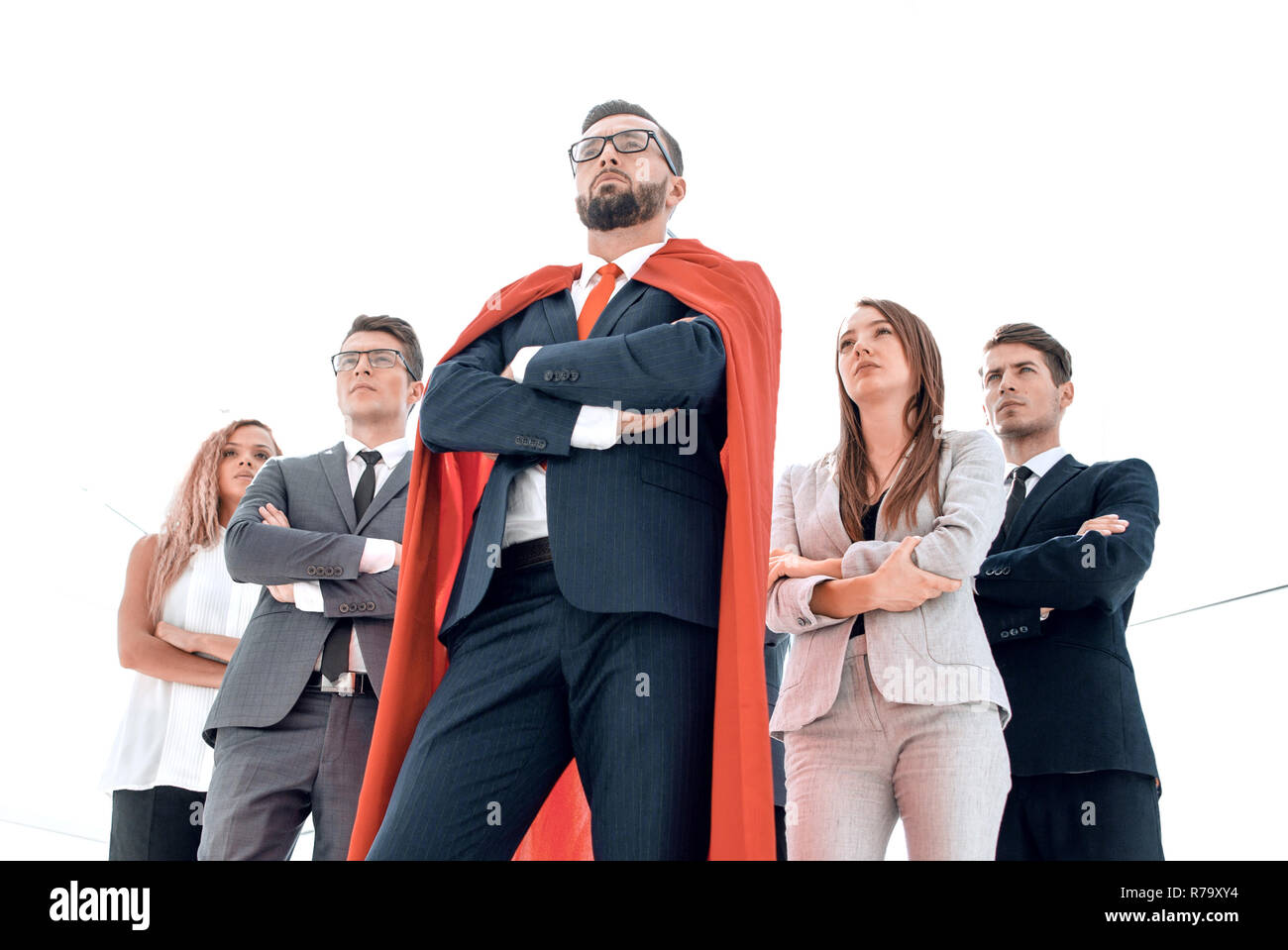 leader in the red cloak and the business team standing together - Stock Image
