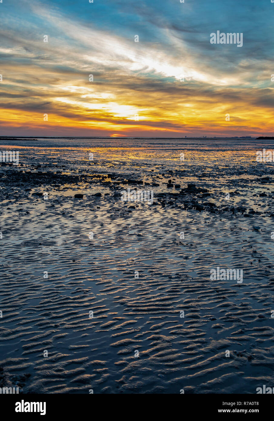 Sunset at low tide over the beach at Chatelaillon Plage near La Rochelle in the Charente-Maritime department of southwest France. Stock Photo