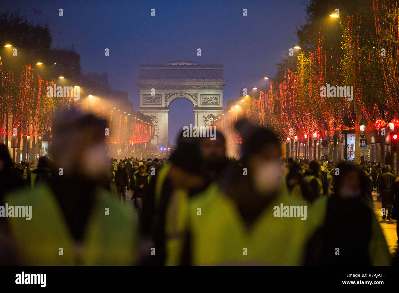 Paris, France. 8th Dec 2018. Protesters seen walking peacefully on the Champs-Elysées during a 'Yellow Vest' protest in Paris. Without any political affiliation, the 'Yellow Vest' movement rallies in various cities in France this saturday against taxes and rising fuel prices. Credit: SOPA Images Limited/Alamy Live News Stock Photo