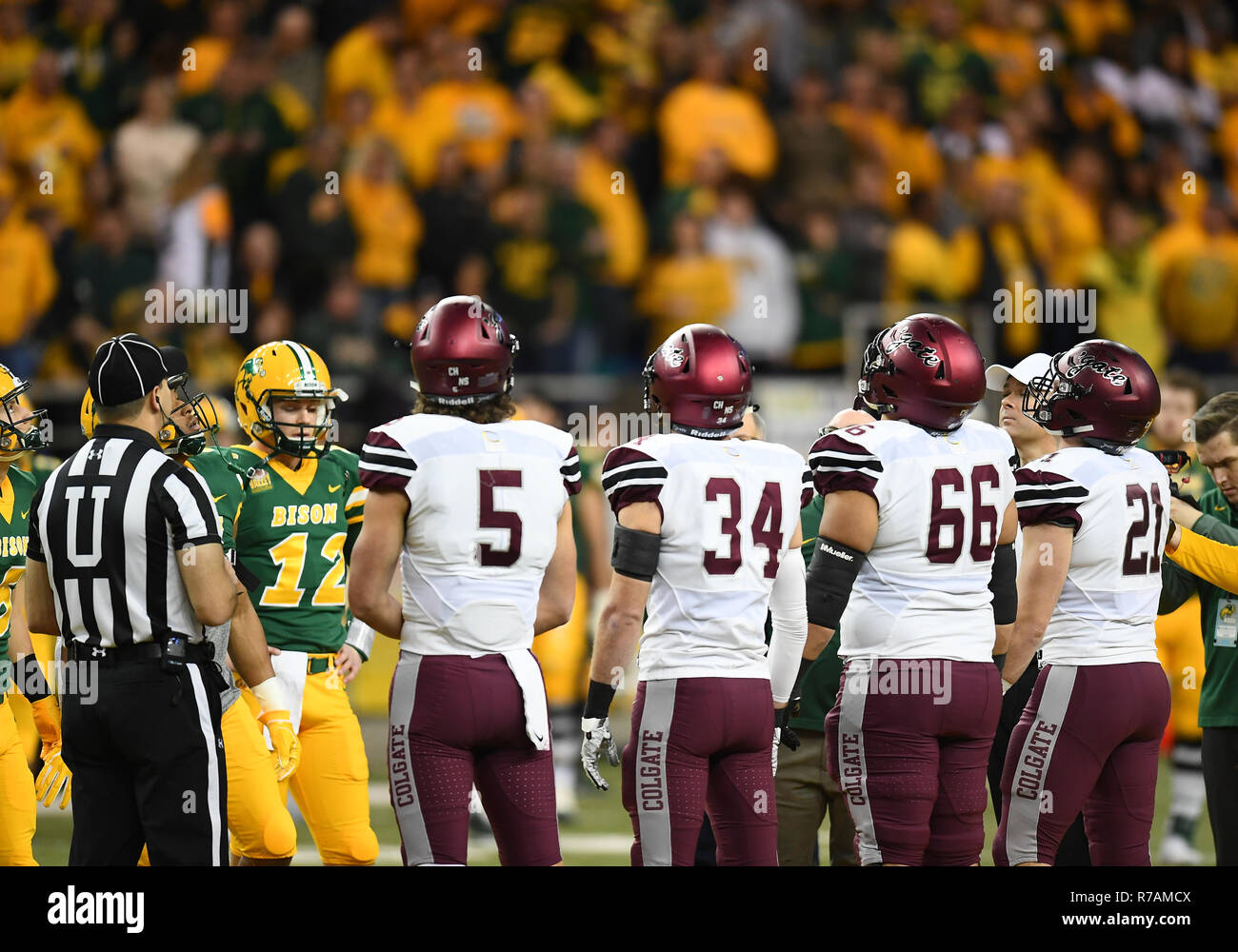 December 8, 2018: Players gather for the coin flip before a NCAA FCS playoff quarter final football game between the Colgate University Raiders and the North Dakota State Bison at the Fargo Dome, Fargo, North Dakota. North Dakota State defeated Colgate 35-0. Photo by Russell Hons - Stock Image