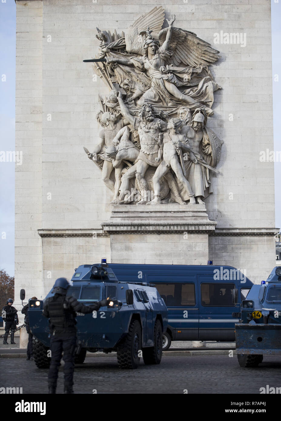 """Paris, France. 8th Dec, 2018. Armored vehicles seen arriving at the Arc De Triomphe during a 'Yellow Vest' protest in Paris.Without any political affiliation, the """"""""˜Yellow Vest' movement rallies in various cities in France this saturday against taxes and rising fuel prices. Credit: Sathiri Kelpa/SOPA Images/ZUMA Wire/Alamy Live News Stock Photo"""