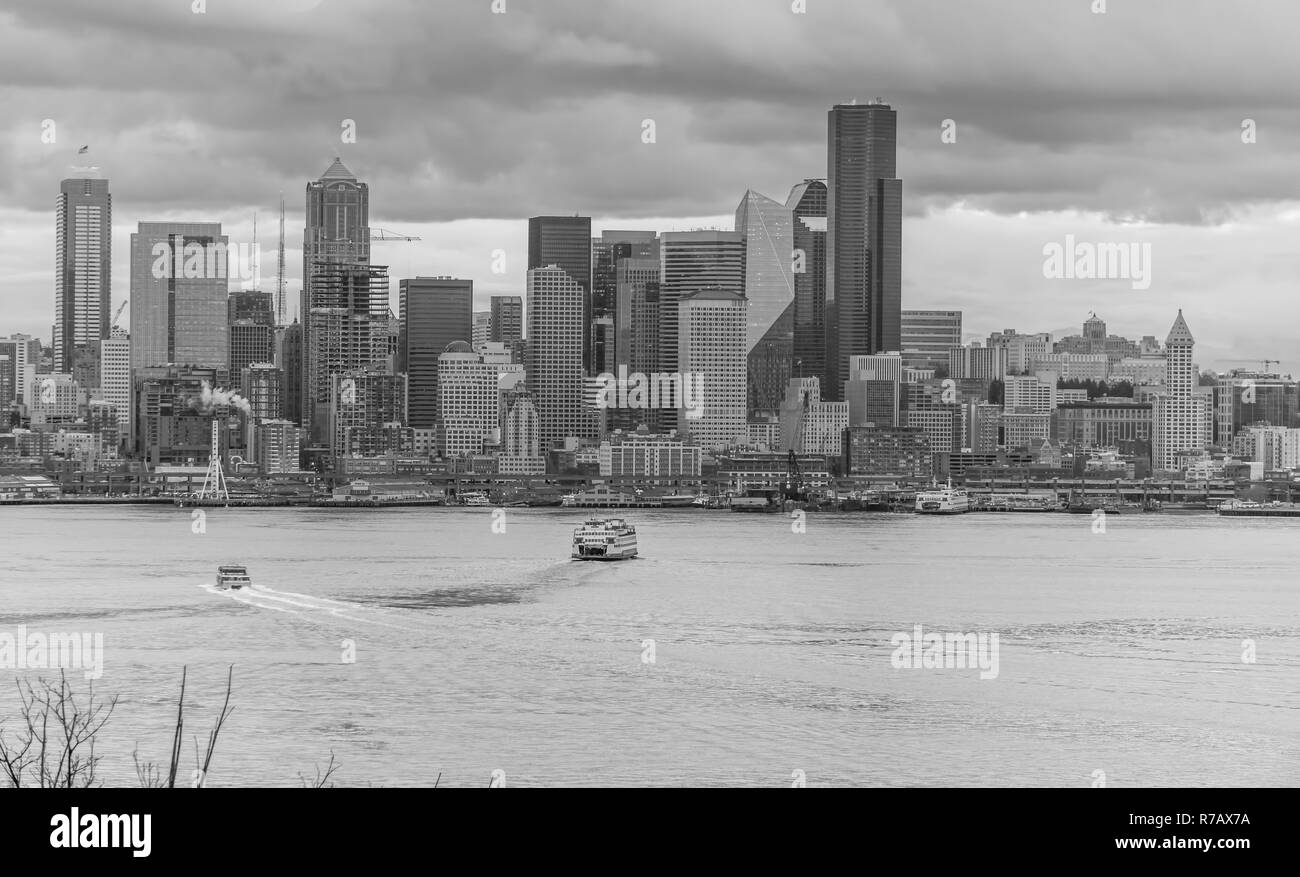 A view of the Seattle skyline with dark clouds overhead. - Stock Image