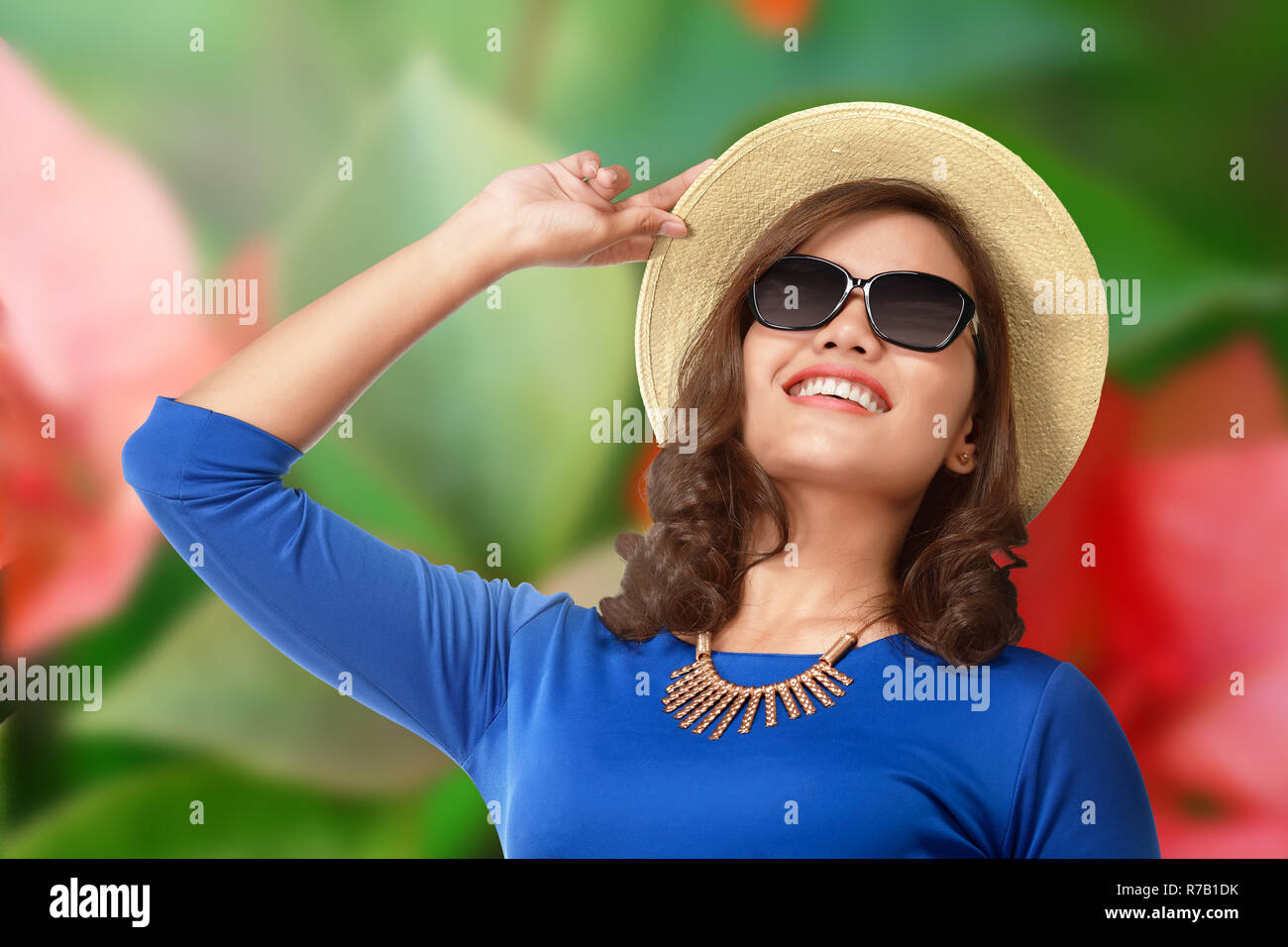 ed34576cc6ae Smiling asian tourist woman with hat and eyeglasses Stock Photo ...