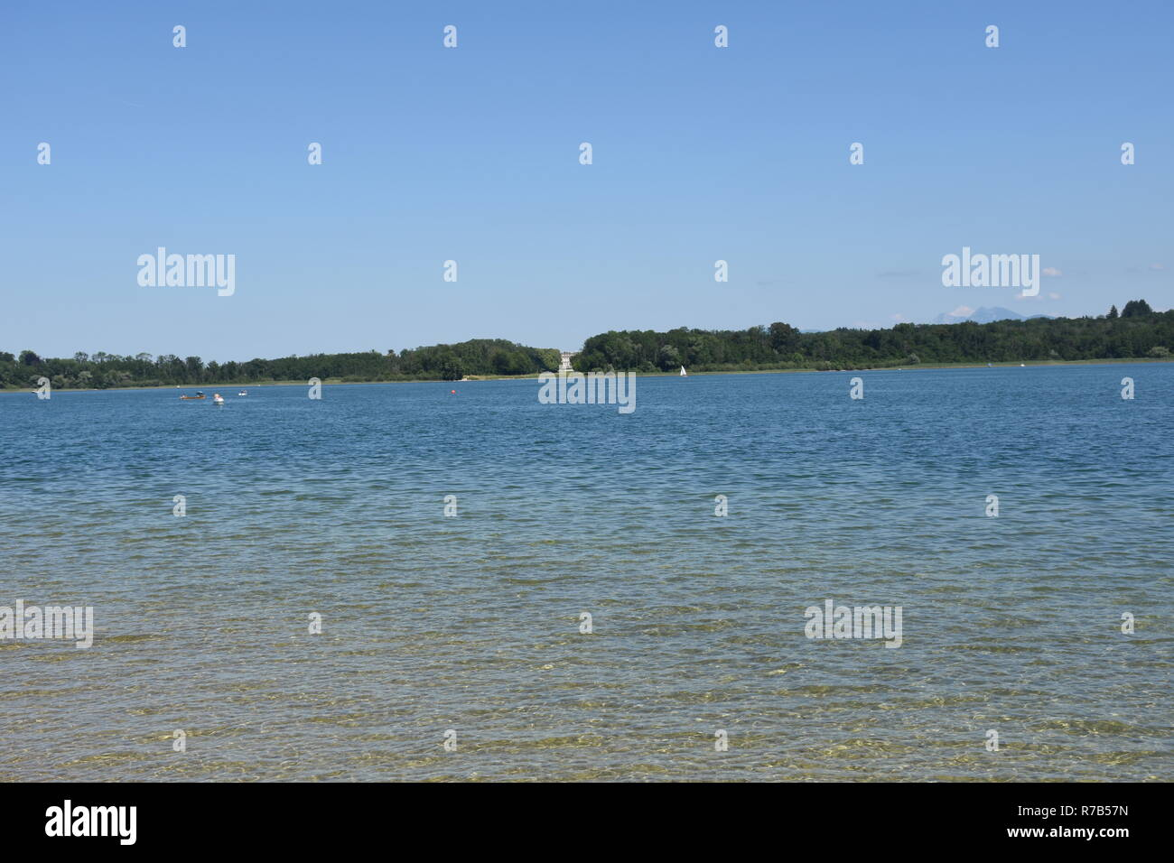 chiemsee,prien,jetty,jetty,path,wharf,wood,lake,chiemgau,herreninsel,fraueninsel,chiemgau alps,alpine foothills,wilder kaiser,rosenheim,loferer steinberge,water,boat,island,sailboat,sailing,beach,shore,bathing beach ,lighting,fr - Stock Image