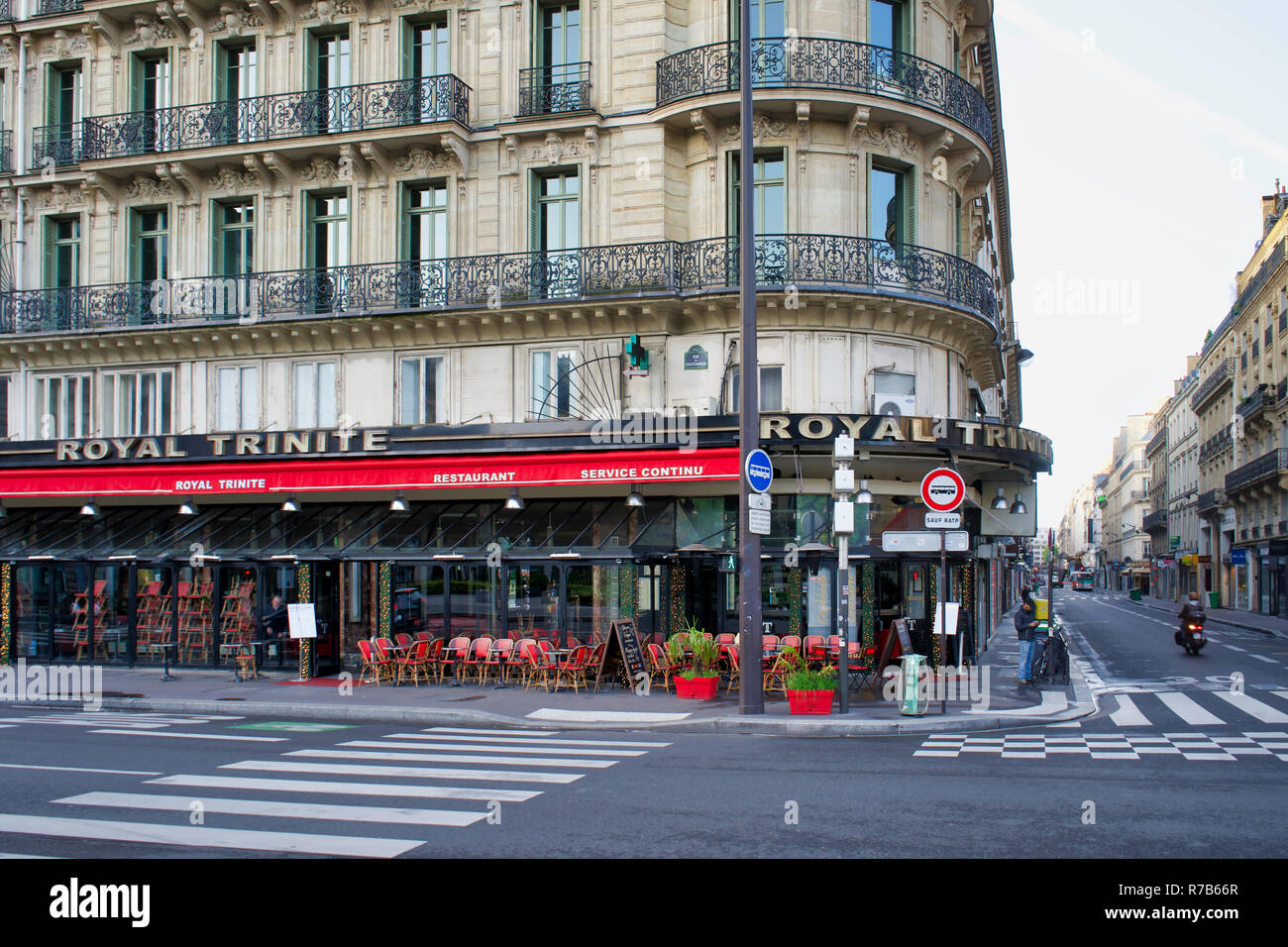 PARIS, FRANCE - MAY 26, 2018: Old city building in the 9th arrondissement, the restaurant Royal Trinite on the first floor Stock Photo