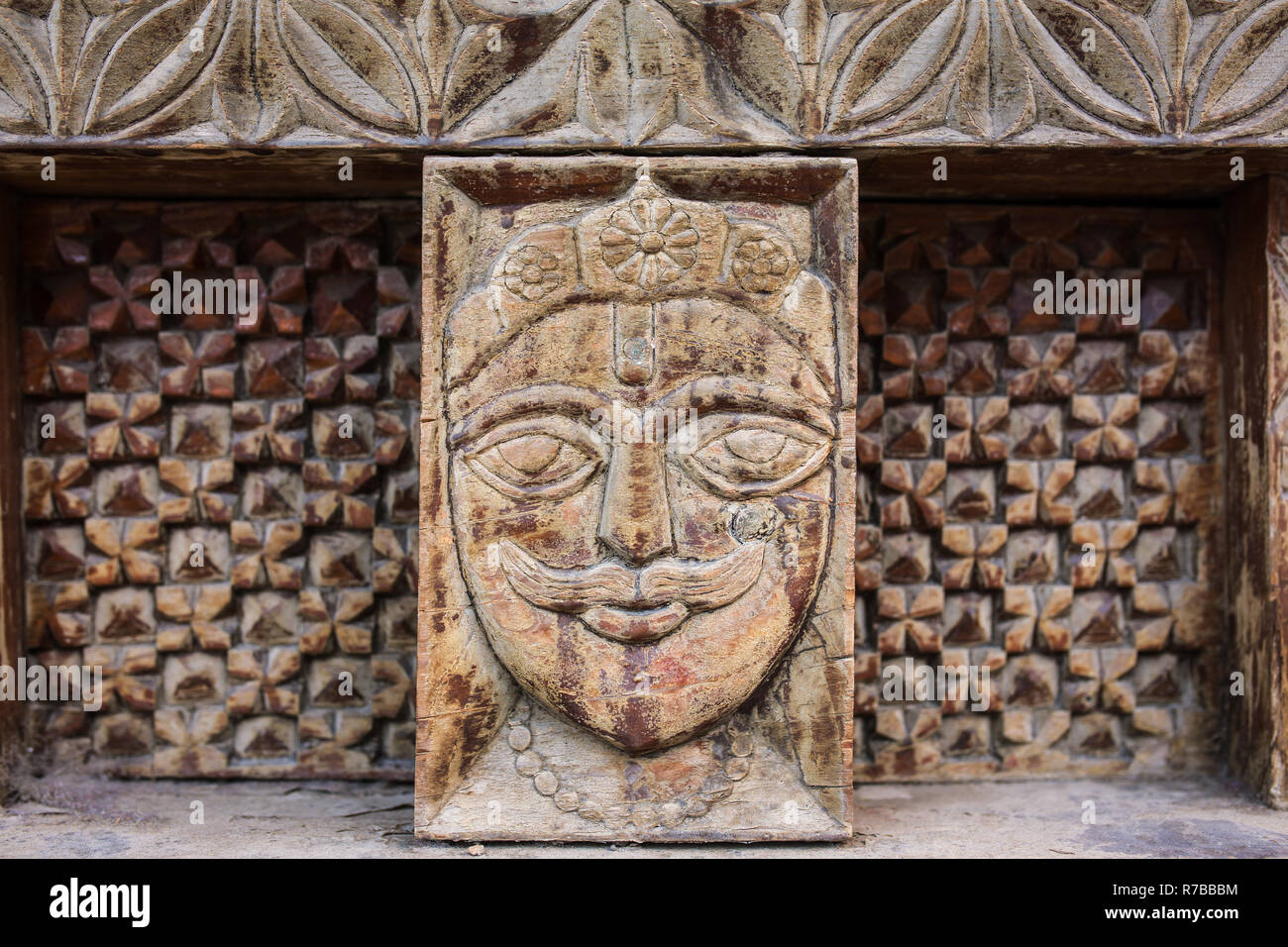 Vashisht, India - May 27, 2017: Traditional wooden carving on the hindu temple in Vashisht village in Kullu valley, Himachal Pradesh, India - Stock Image