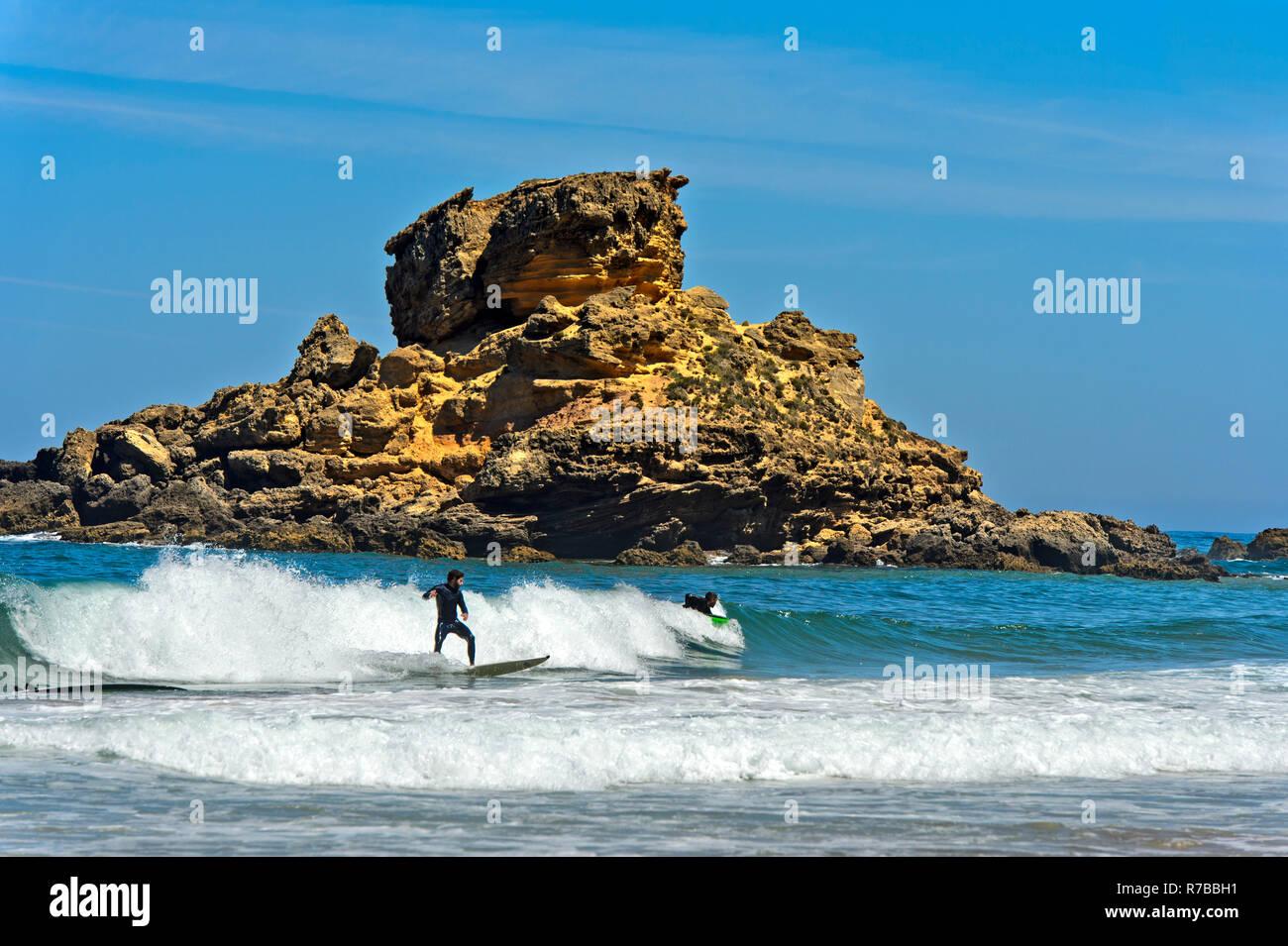 Surfer at the Costa Vicentina coast, Vila do Bispo, Portugal - Stock Image