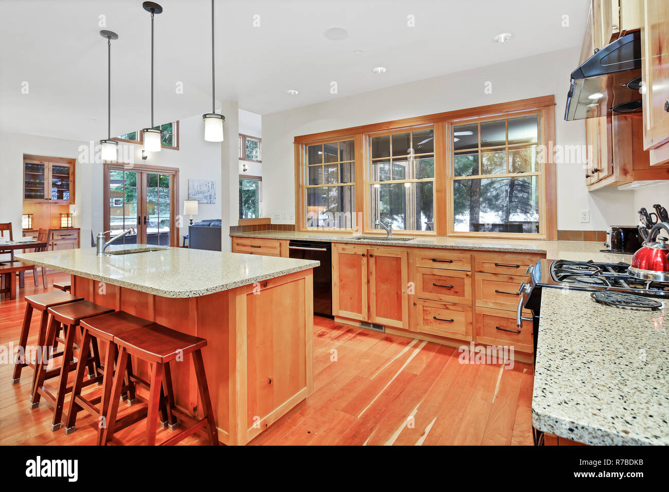 Beautiful Kitchen With Light Wood Cabinets Granite Counter Tops And Black Appliances Stock Photo Alamy