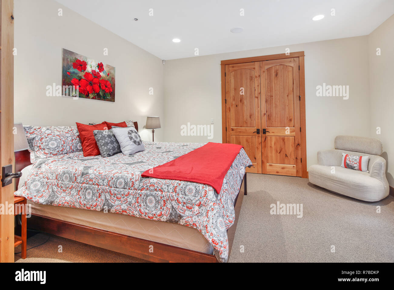 Lovely bedroom interior with soft beige walls and master bed ...
