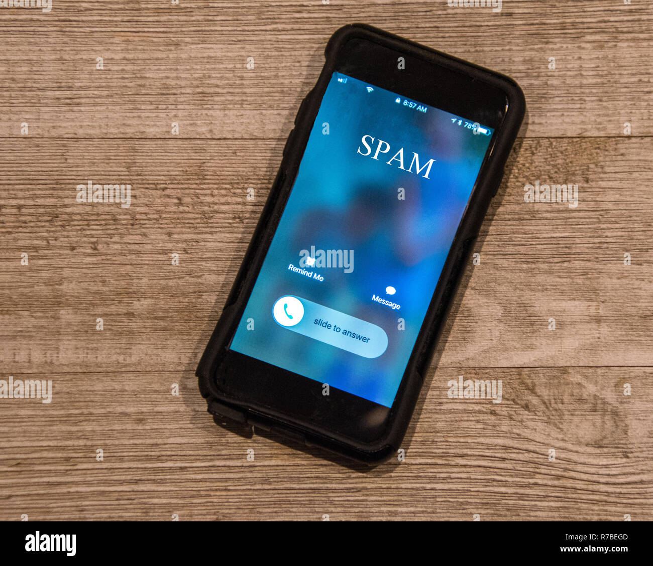 Cell Phone showing call from, Spam - Stock Image