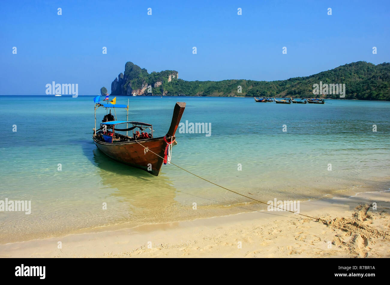 Phi Phi Islands Beaches Loh Dalum Tonsai Bay Long Beach: Longtail Boat Anchored Stock Photos & Longtail Boat