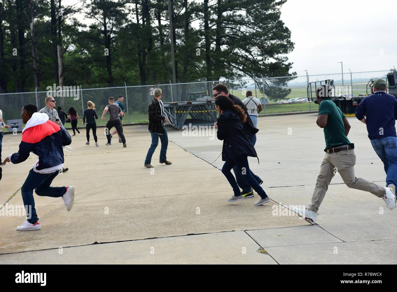 Participants run away from a simulated explosion during a Major