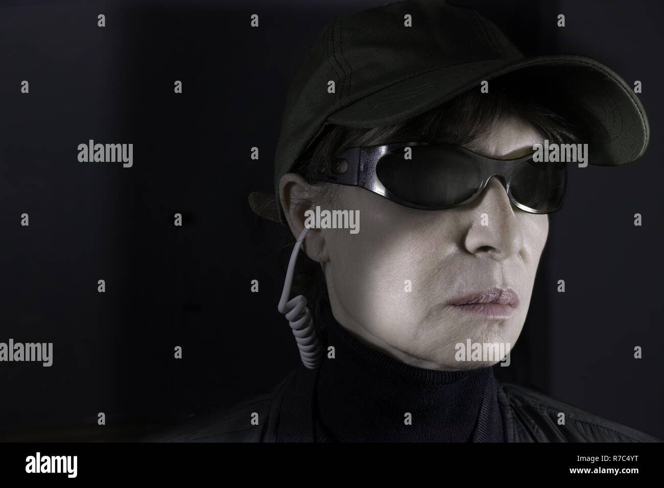 The very severe face of a female cop from secret services. - Stock Image