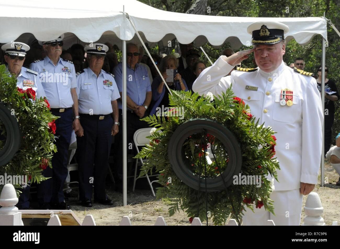 Canadian Naval Attaché Capt  Dermott Mulholland salutes