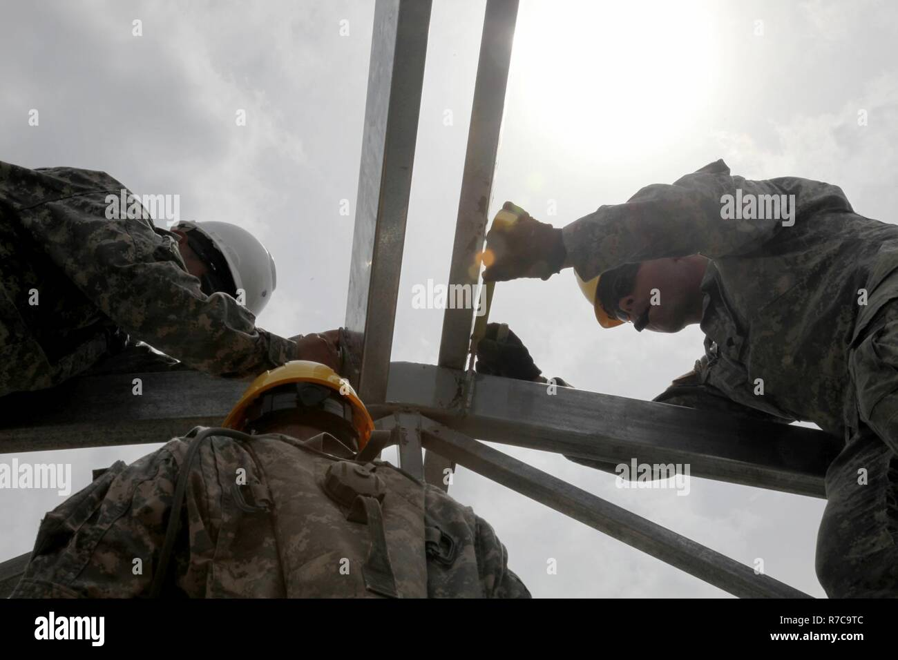 U S Army Spc Judah Fenske With The 485th Engineer Company Measures The Anchor Points Of A Support Beam For The Roof Of The Future Medical Clinic In Double Head Cabbage Belize May