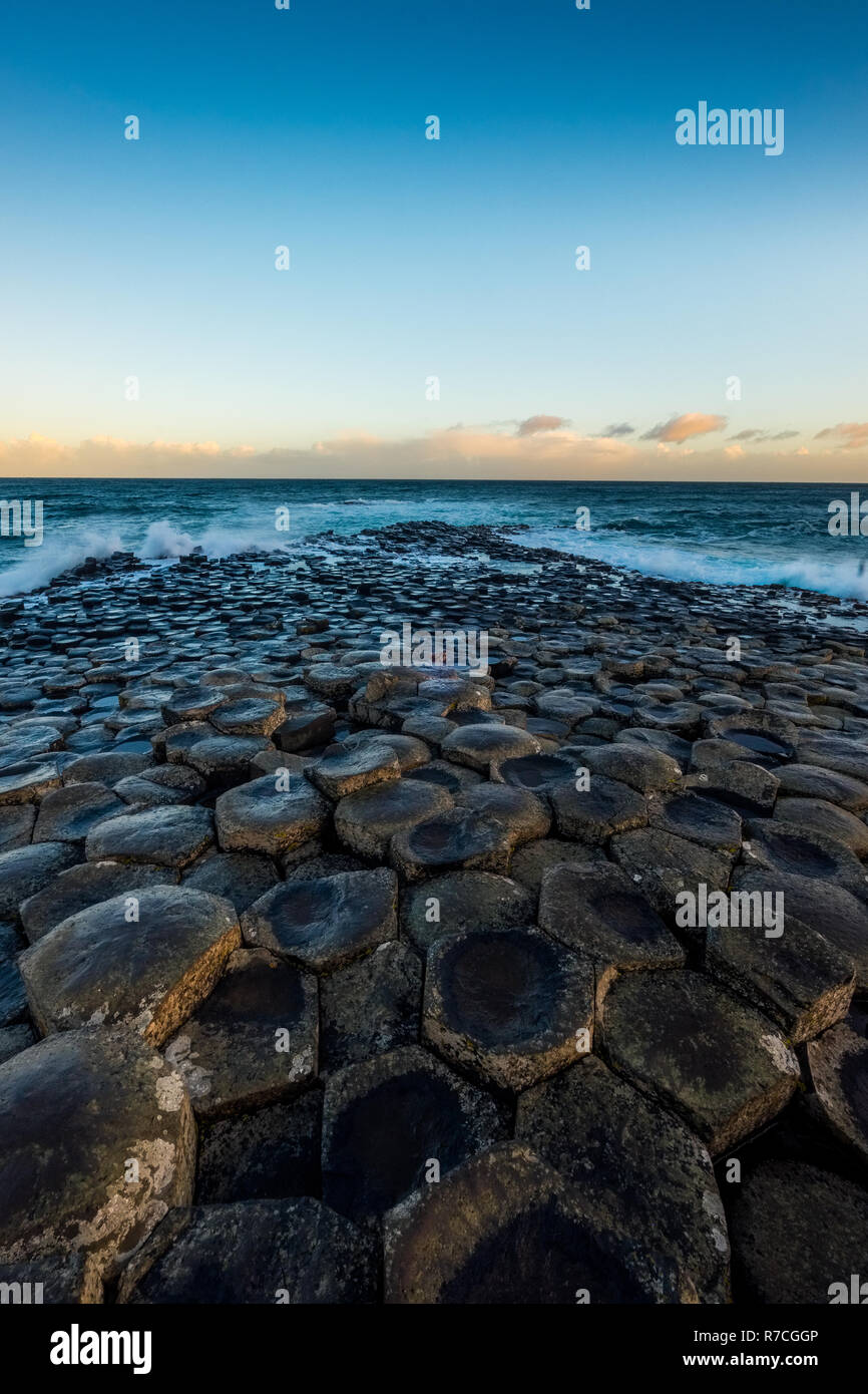 Landscape around Giant`s Causeway, A UNESCO world heritage site which has numbers of interlocking basalt columns result of an ancient volcanic fissure Stock Photo