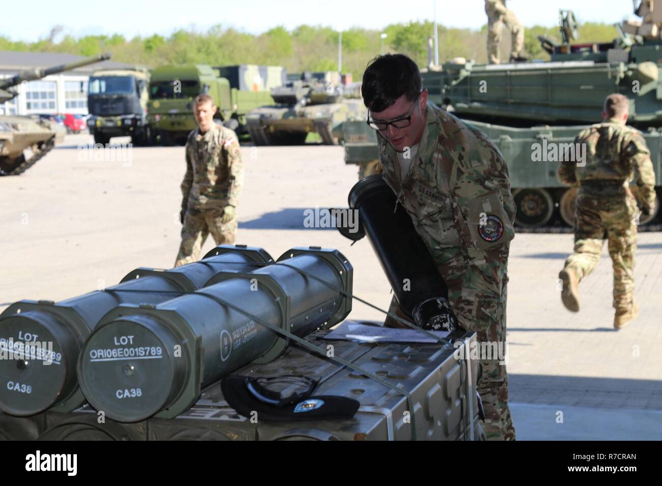 1st Lt. Elisha Gueli, a platoon leader for Battle Company, 1st Battalion, 66th Armor Regiment, 3rd Armored Brigade Combat Team, 4th Infantry Division, unloads ammunition from an M1A2 Abrams tank during the Nordic Tank Challenge hosted by the Danish 1st Armoured Battalion, Jutland Dragoons Regiment, at Holstebro Barracks, Dragonkasernen, Denmark, May 15, 2017. The U.S. team's two tank crews have used the competition as a chance to build camaraderie with participating crews from Canada, Denmark, Germany, Norway and Sweden. Stock Photo
