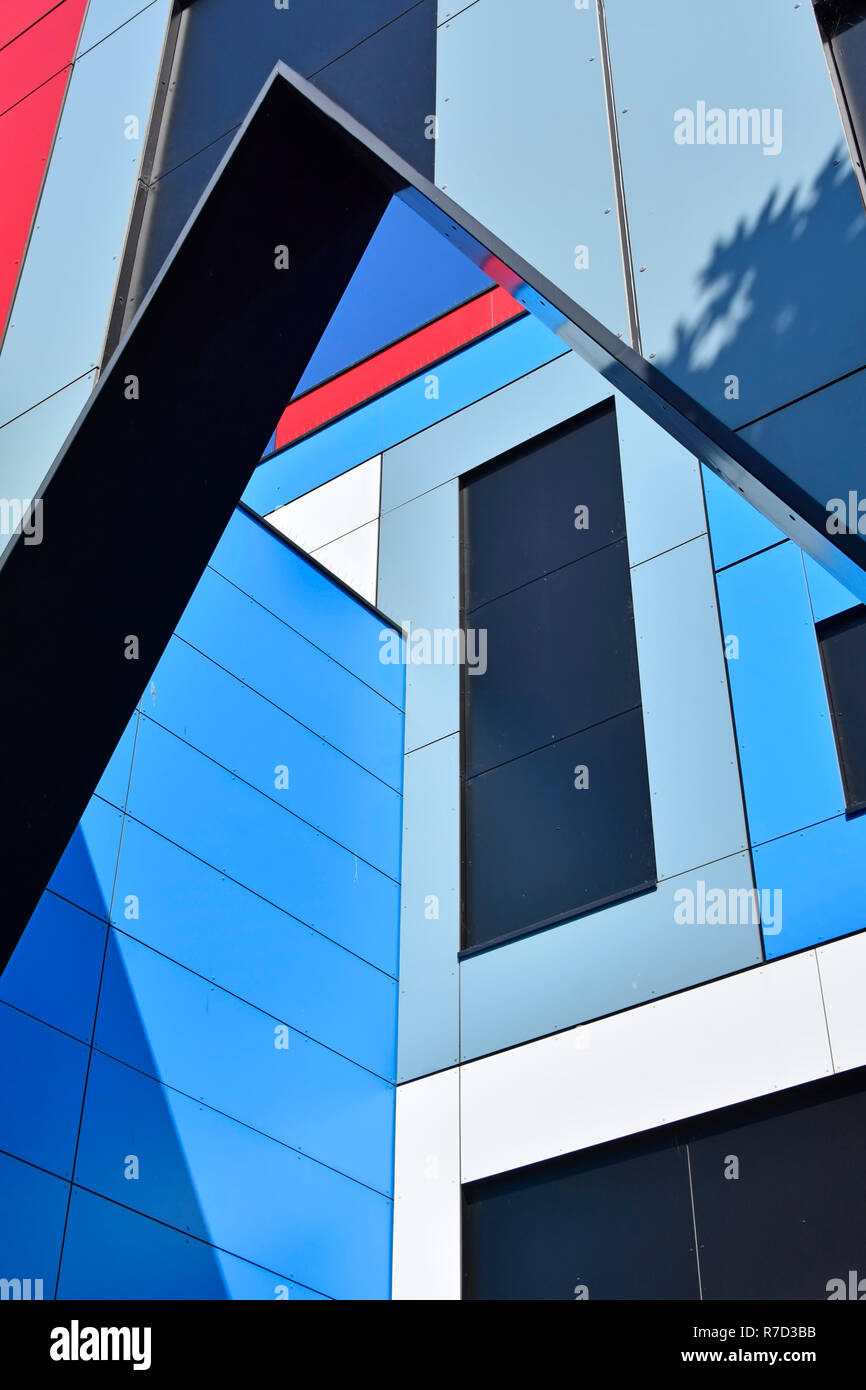 Modern architecture building detail & structure form abstract angular geometric lines  pattern shapes colour triangles rectangles & shadows England UK - Stock Image