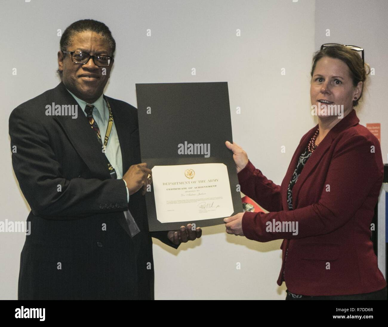 Deb Czombel, Buffalo District Supervisory Program Analyst, awards Dr. Andrew Jackson, Buffalo District Workforce Development Program Specialist, with a Certificate of Achievement after he hosts a lunch-and-learn presentation on institutional racism at the District reservation, December 3, 2018. - Stock Image