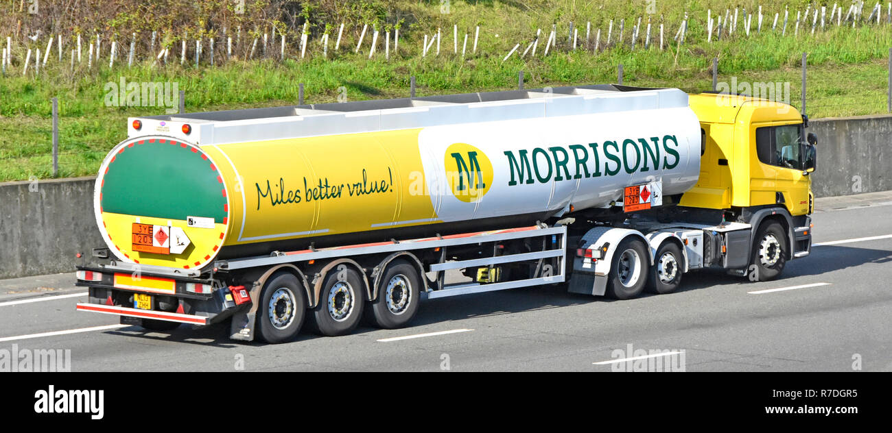 Morrisons supermarket supply chain lorry truck transport logistics & articulated fuel petrol diesel tanker delivery service motorway Essex England UK - Stock Image