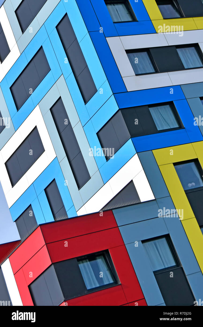 Abstract building architecture using colour shapes on colourful modern student accommodation architectural geometric pattern corner detail England UK - Stock Image