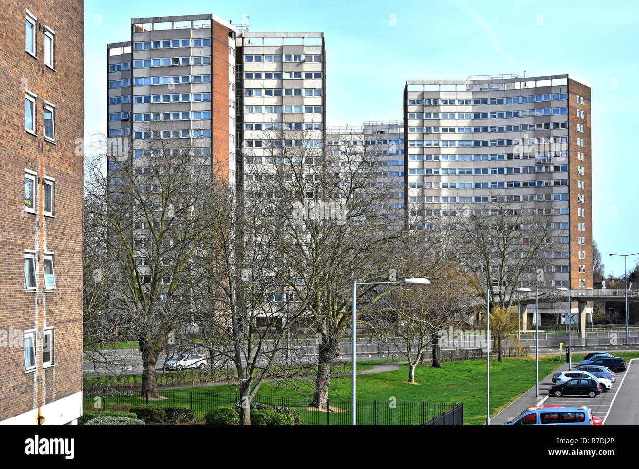 Part of a council housing estate of high rise block of homes & flats seen beyond winter trees close to town centre Southend on Sea Essex England UK Stock Photo