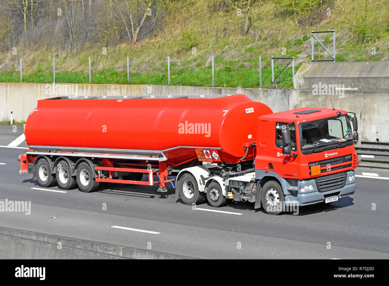 Red Murco transport logistics hgv truck & articulated supply chain transportation fuel petrol diesel tanker delivery lorry motorway Essex England UK - Stock Image