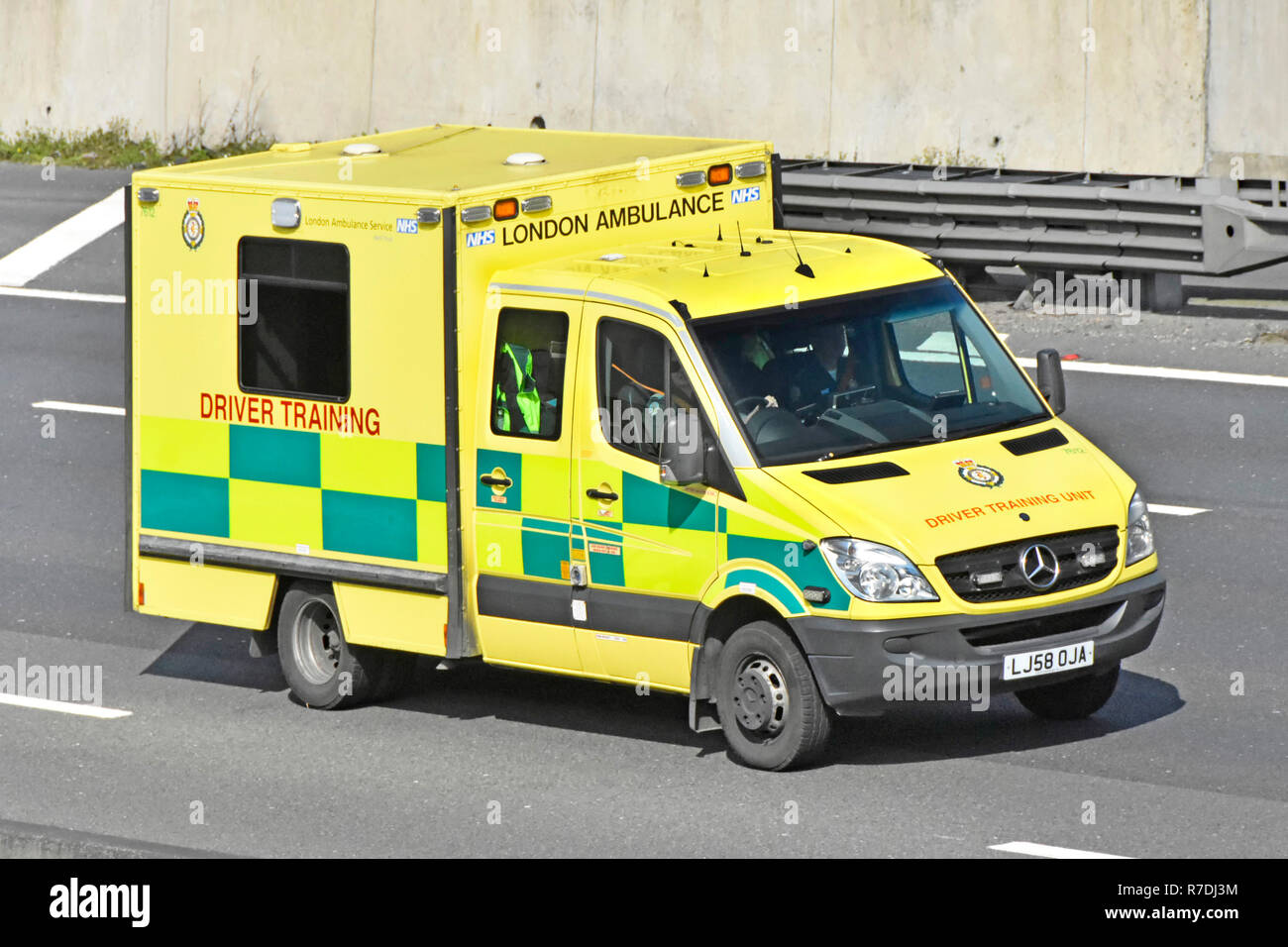 Modified London NHS ambulance driver training & instruction vehicle for education learning practice driving session on M25 motorway Essex England UK - Stock Image