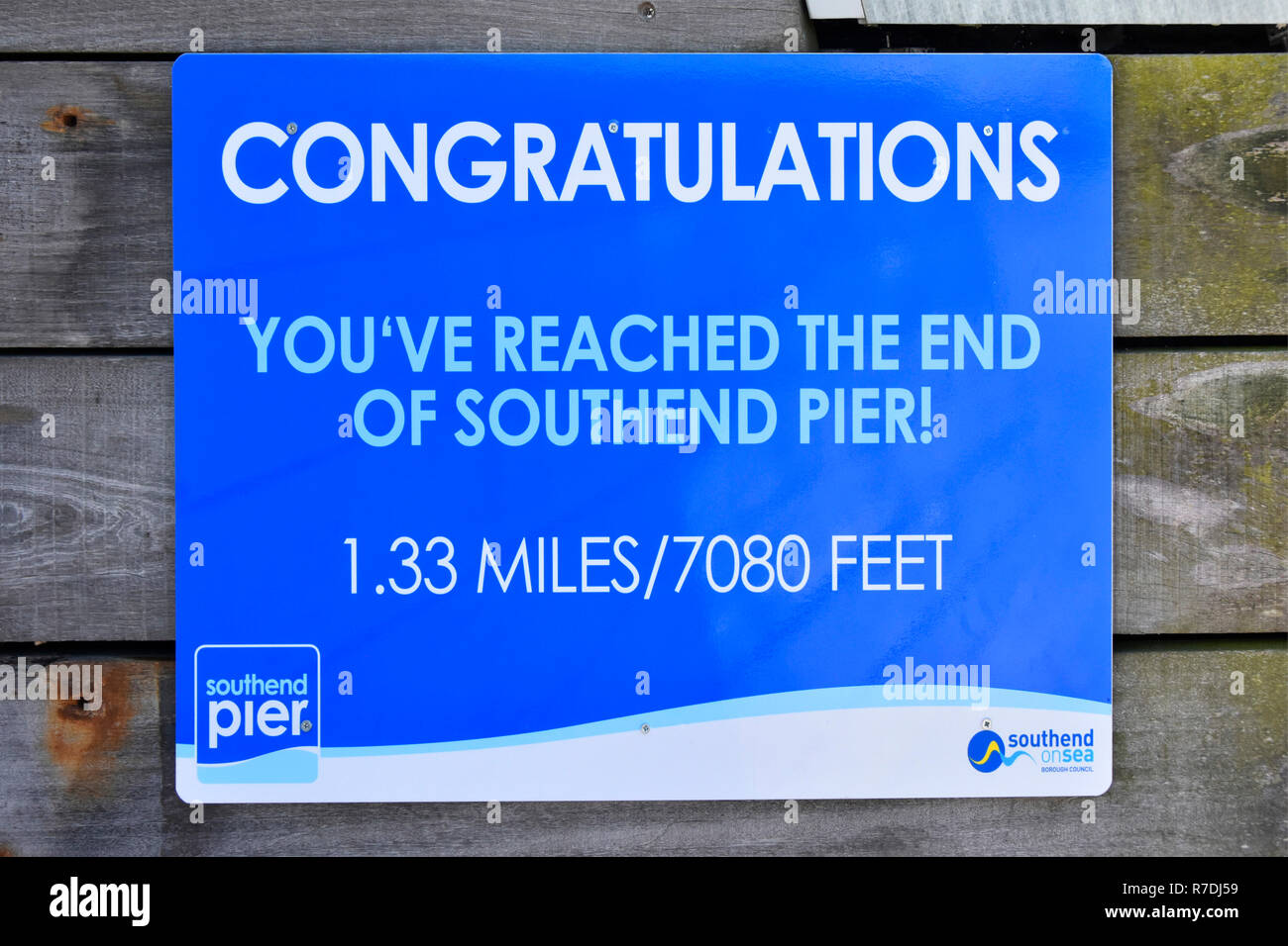 Congratulations sign to walkers on famous longest distance pleasure pier in the world at Southend on sea River Thames estuary seaside Essex England UK - Stock Image