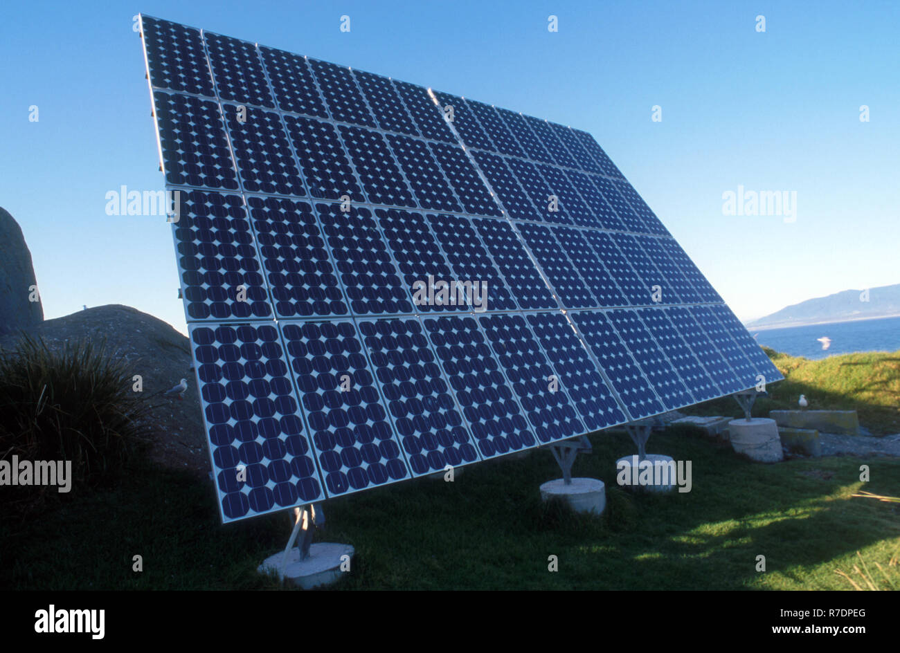 FLAT BANK OF SOLAR PANELS ON MONTAGUE ISLAND OFF THE COAST OF NAROOMA, NEW SOUTH WALES, AUSTRALIA - Stock Image