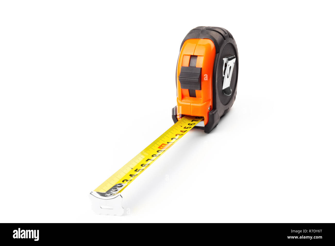 Black and orange tape measure with a yellow tape on a white background - Stock Image
