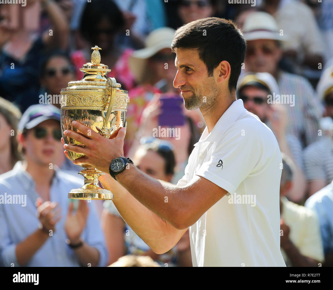 Serbian player Novak Djokovic during trophy presentation at Wimbledon, London, United Kingdom. - Stock Image