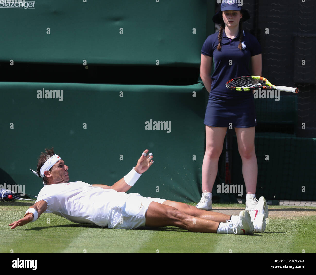 Spanish player Rafael Nadal falls to the ground, Wimbledon, London, United Kingdom. - Stock Image