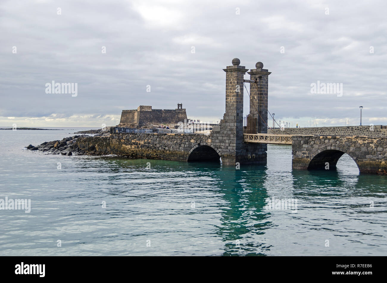 Castle of Saint Gabriel (Castillo de San Gabriel) and the bridge with Castle Doors Puente de Las Bolas on a small island in Atlantic in  Arrecife Stock Photo