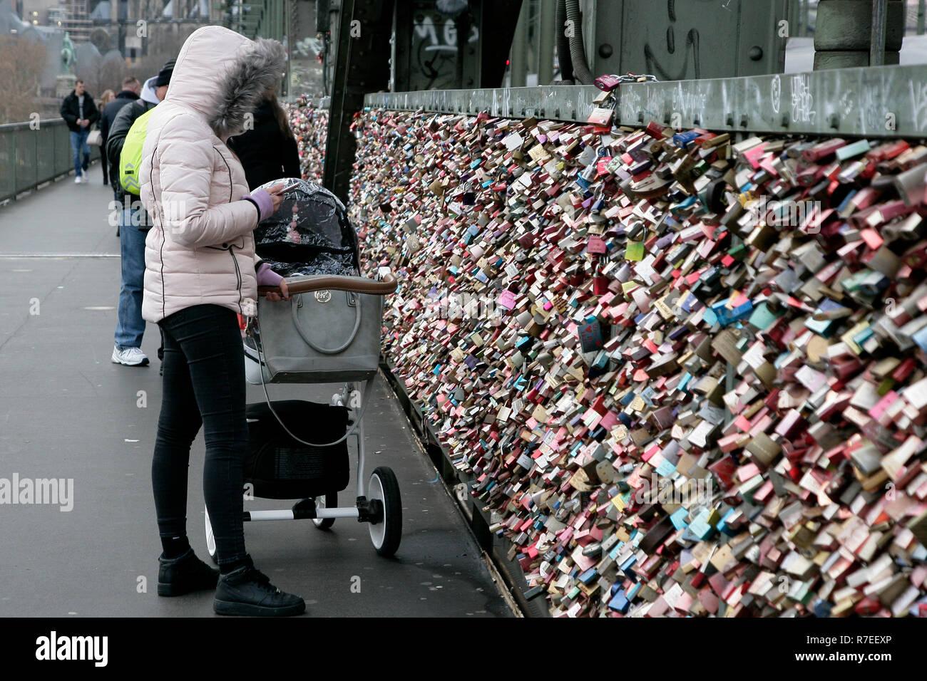 A woman seen looking at the love locks on the bridge  Love locks