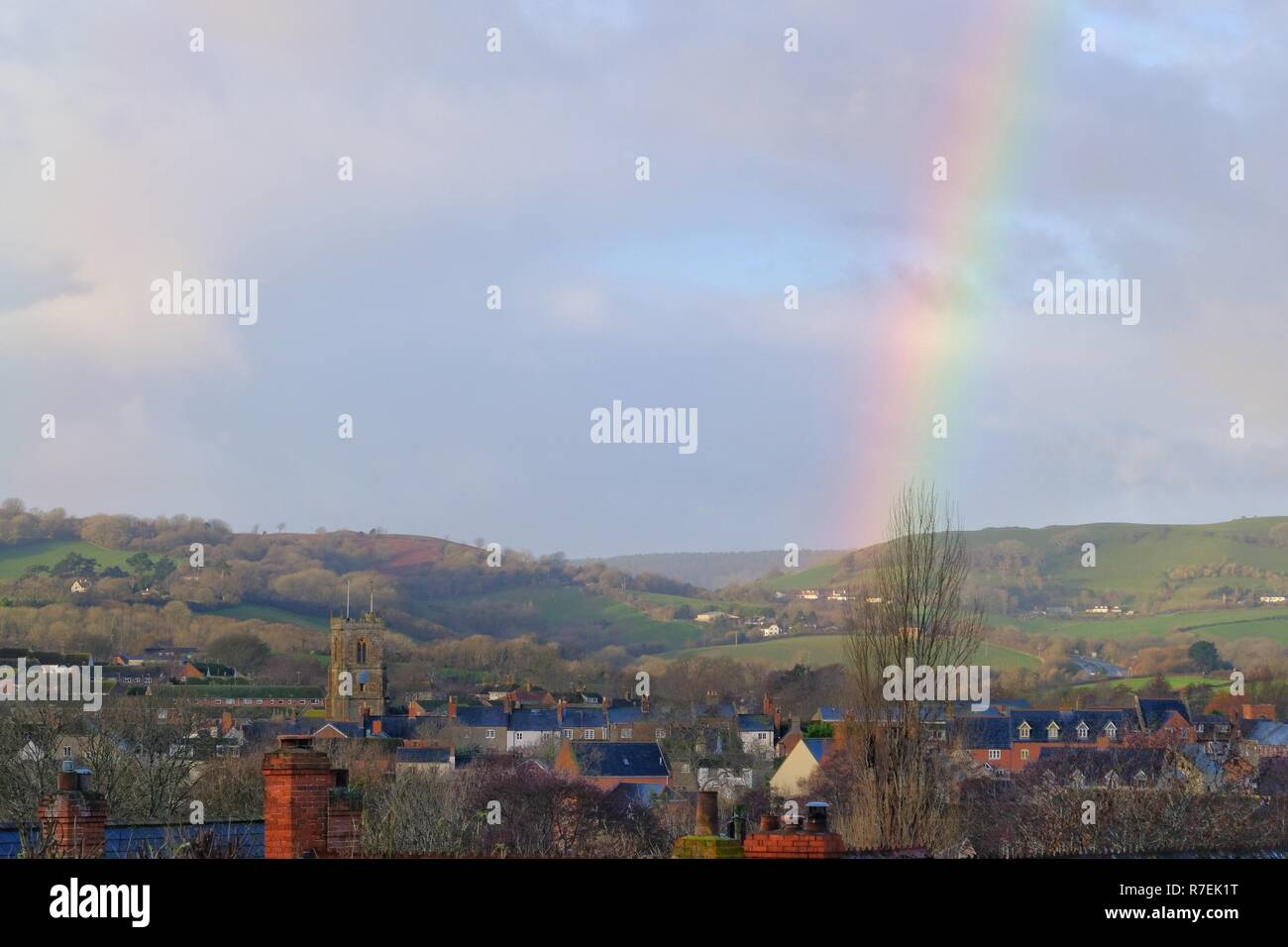 Dorset, UK. 9th Dec 2018. A rainbow appears overBridport town in Dorset as the heavy rain of the past two days begins to clear. Credit: Tom Corban/Alamy Live News - Stock Image