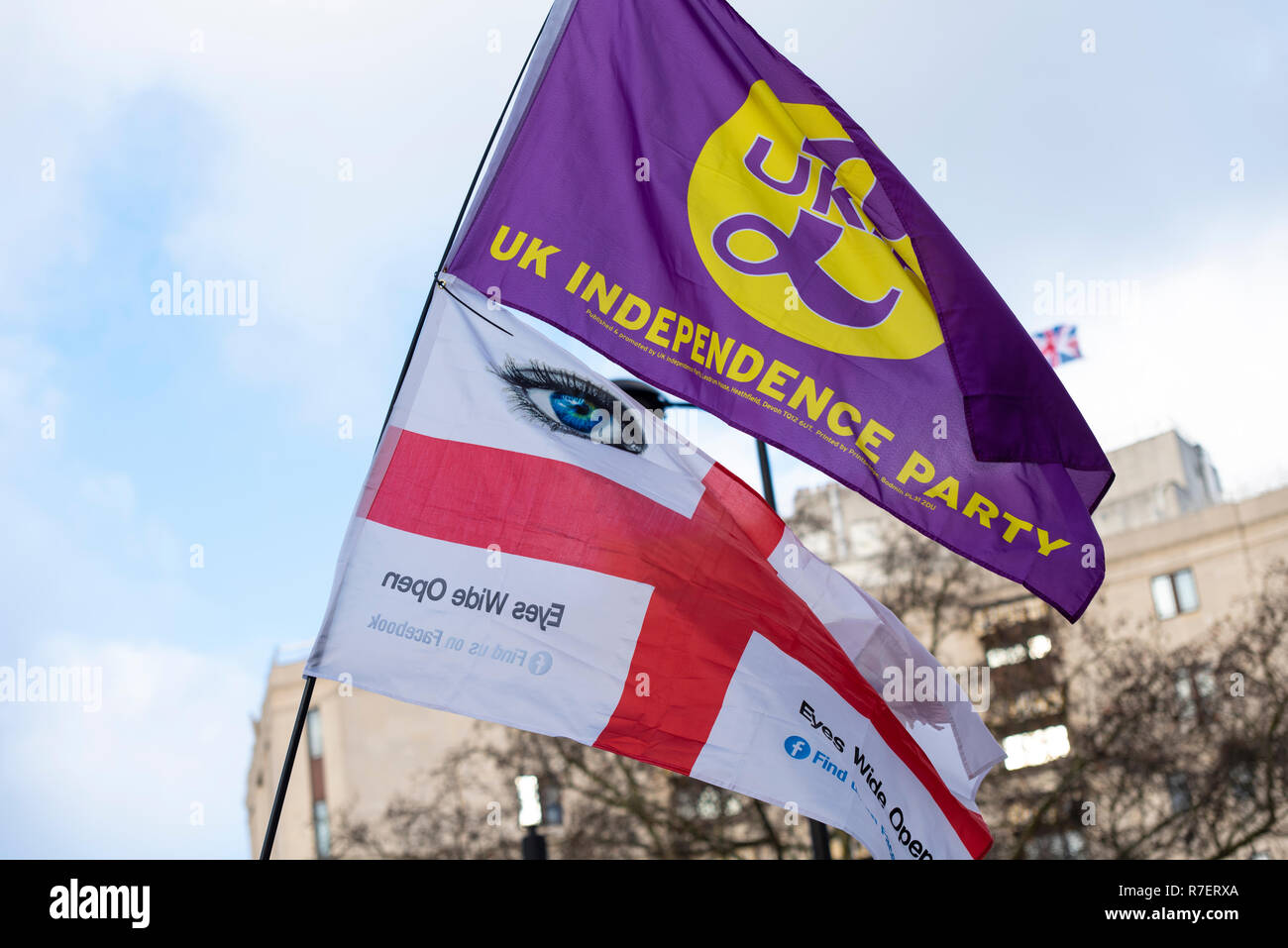 Brexit Betrayal march. Protesters are demonstrating at what they see as a betrayal by the UK government in not following through with leaving the EU in its entirety after the referendum. UKIP flag and Eyes wide open flag - Stock Image