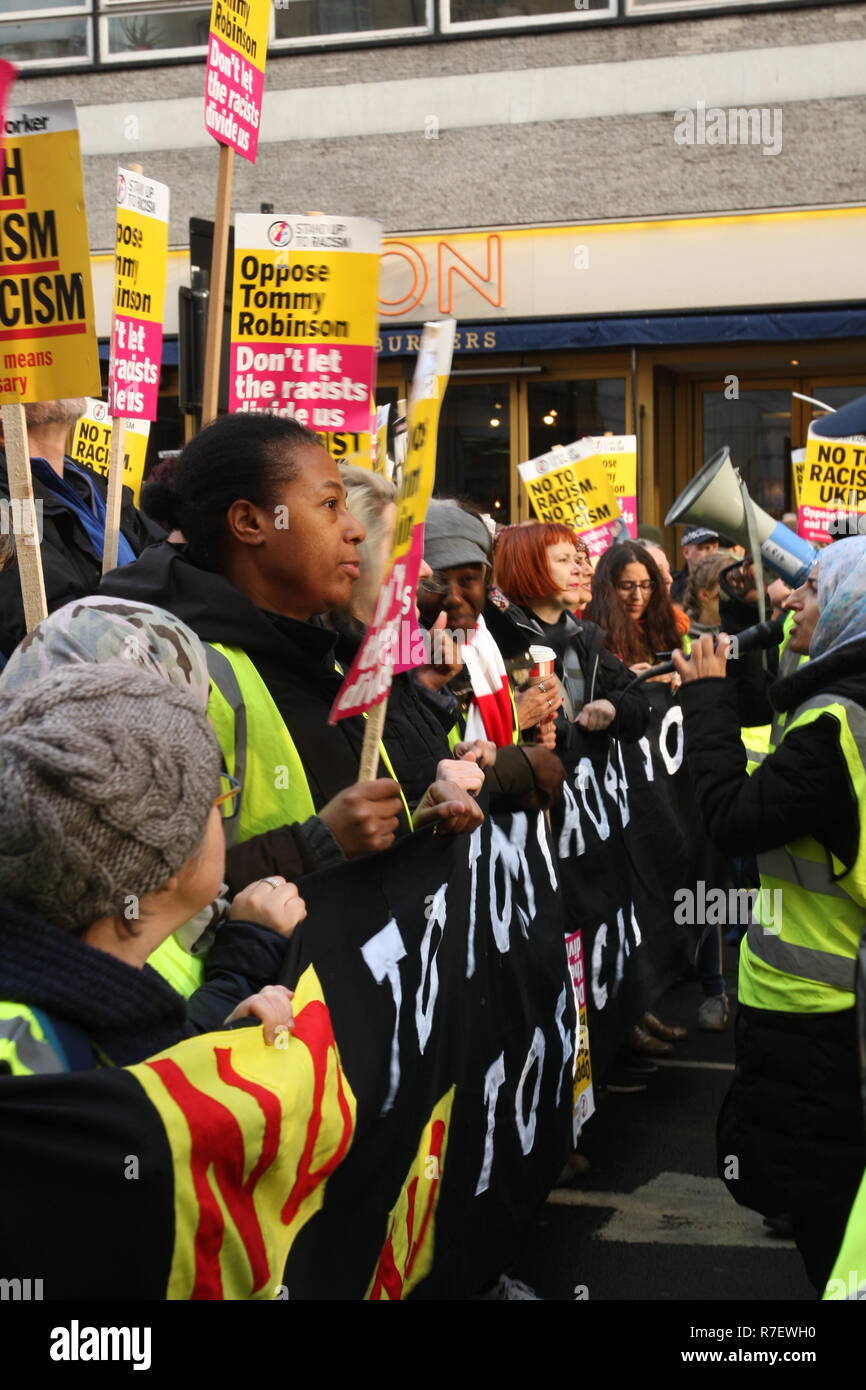 London, UK, 9th December 2018. A demonstration that organisers described as being for all anti-fascists, regardless of their positions on leave/remain on Brexit, opposes 'Tommy Robinson, fascism and racism.   A line of women held the banner leading the march. The march from the BBC, Portland Place to Whitehall is a counter protest against one called by Robinson and UKIP. Roland Ravenhill / Alamy Live News - Stock Image