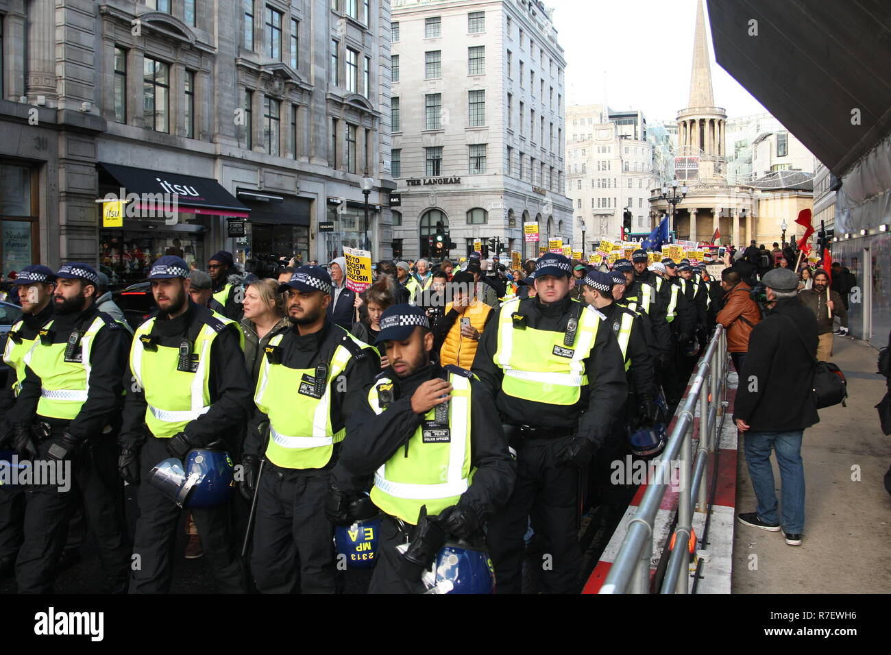 London, UK, 9th December 2018. A demonstration that organisers described as being for all anti-fascists, regardless of their positions on leave/remain on Brexit, opposes 'Tommy Robinson, fascism and racism.   The march from the BBC, Portland Place to Whitehall is a counter protest against one called by Robinson and UKIP, and was heavily policed. Roland Ravenhill / Alamy Live News - Stock Image
