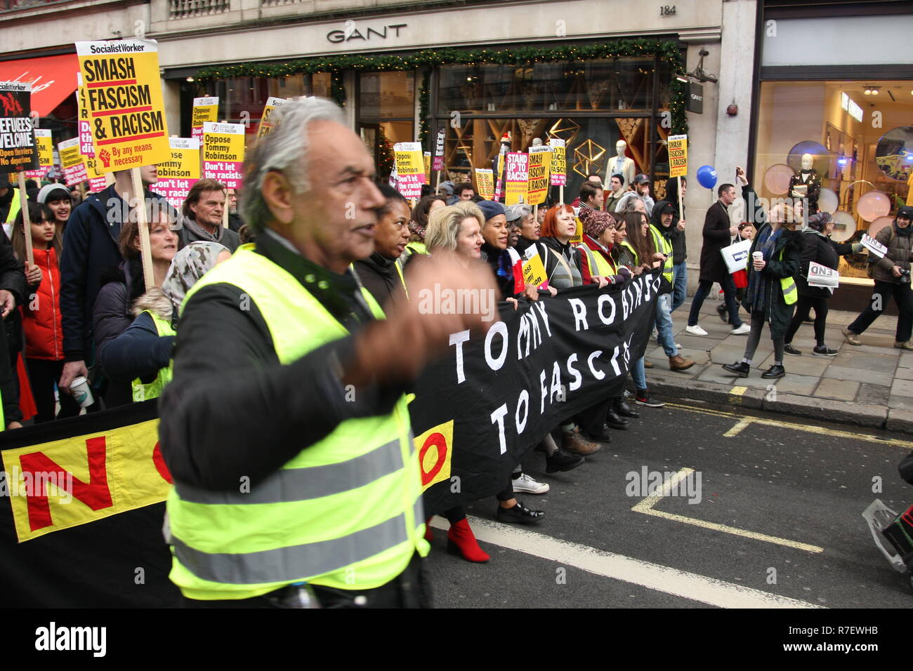 London, UK, 9th December 2018. A demonstration that organisers described as being for all anti-fascists, regardless of their positions on leave/remain on Brexit, opposes 'Tommy Robinson, fascism and racism.   The march from the BBC, Portland Place to Whitehall is a counter protest against one called by Robinson and UKIP. Roland Ravenhill / Alamy Live News - Stock Image